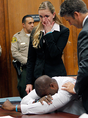 Banks breaks down in a Long Beach courtroom as all charges are finally dismissed. (AP)