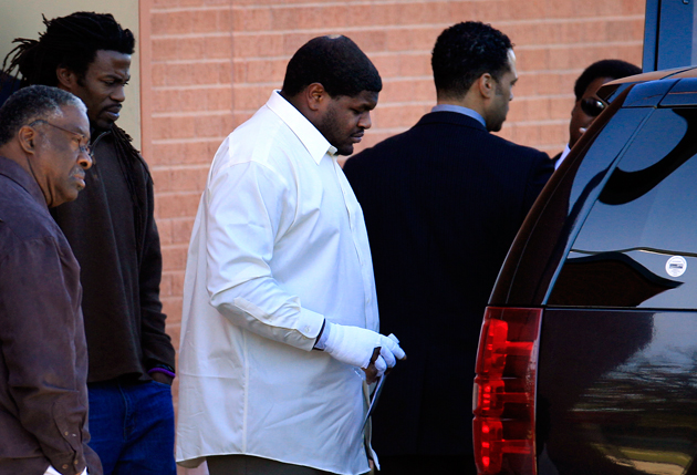 Josh Brent leaves Jerry Brown's memorial service at Dallas' Oak Cliff Bible Fellowship. (AP)