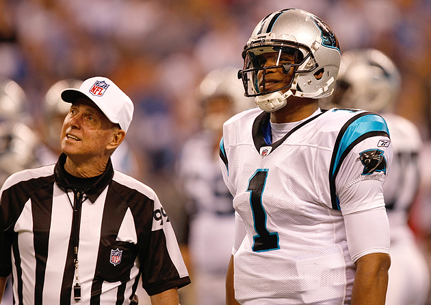 Corrente talks to Carolina's Cam Newton in late November. (Getty Images)