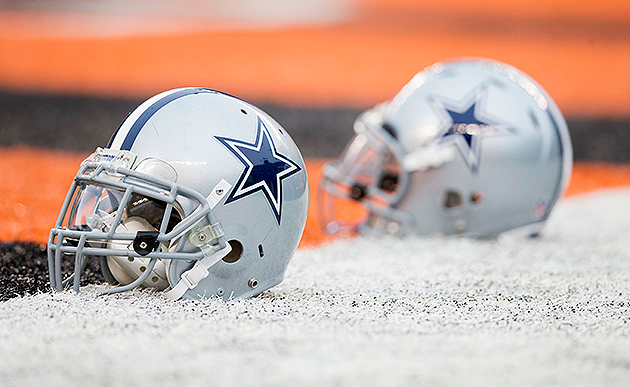 Playing with heavy hearts, the Cowboys found a way to win (US Presswire)