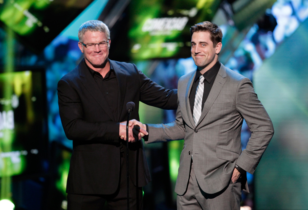 Brett Favre and Aaron Rodgers at the NFL Awards. Rodgers looks like he'd rather be fishing. (AP)