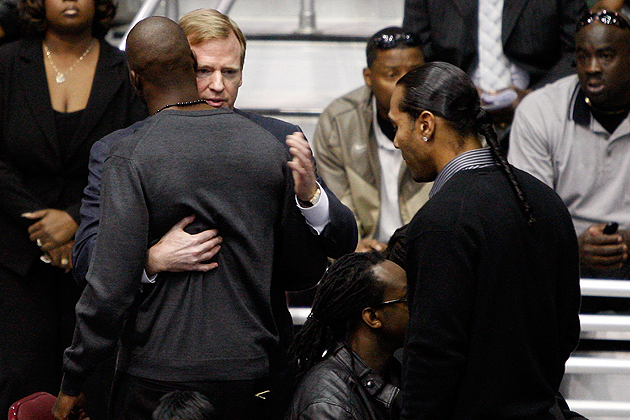Ochocinco and Goodell hug at Chris Henry's funeral in December, 2009. (Getty)