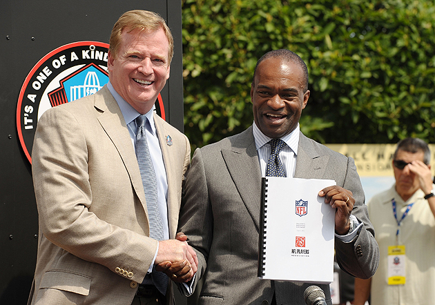 A brief cease-fire: Roger Goodell and DeMaurice Smith ratify a new CBA. (Getty Images)