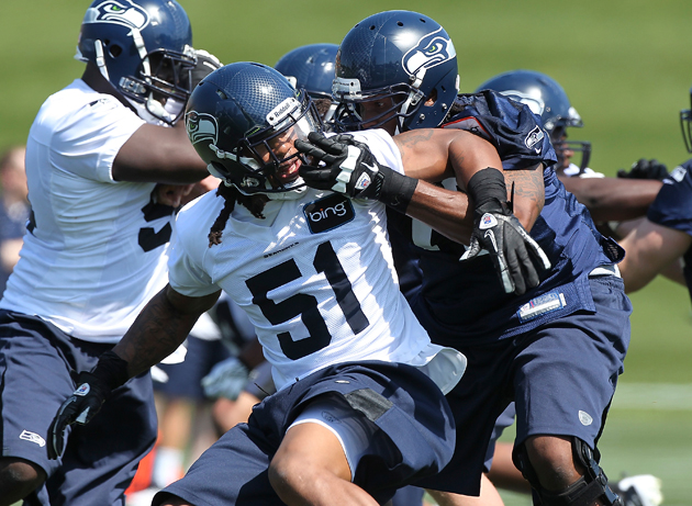 Bruce Irvin got schooled in early practice battles. (Getty Images)