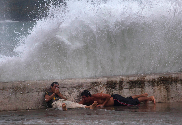 Tropical Storm Isaac batters a Cuban seawall on Saturday, August 25 (AP)