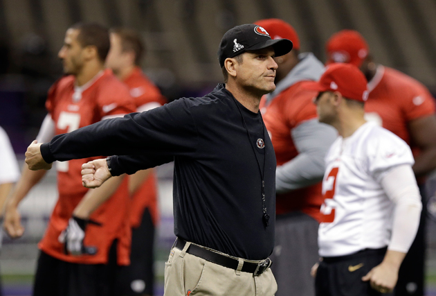 Jim Harbaugh gets loose during the 49ers' Saturday in the Superdome. (AP)
