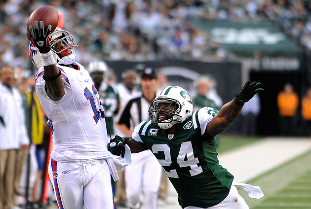 Stevie Johnson grabs a pass over the objections of Darrelle Revis. (AP)