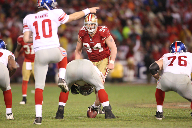 Justin Smith sizes up the Giants' offense during the 2011 NFC championship game. (Getty Images)