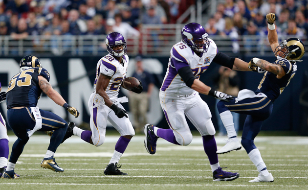 Matt Kalil paves the way for Adrian Peterson. (Getty Images)