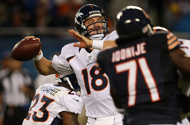 It wasn't an A+ evening, but Peyton Manning passed his first tests. (Getty Images)
