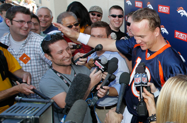 Peyton Manning pats a reporter on the head after an 'interesting' question. (AP)