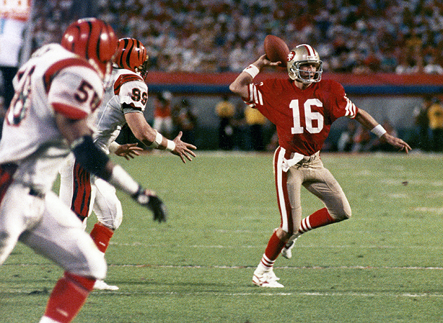 Joe Montana, throwing balloons at darts in Super Bowl XXIII. (Getty Images)