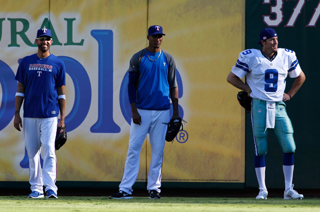 That's Joe Nathan on your right, and a very happy Mike Adams on your left. (AP)