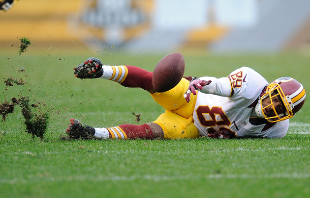 Ker-plunk! Santana Moss lets another pass slip through his grasp. (Getty Images)