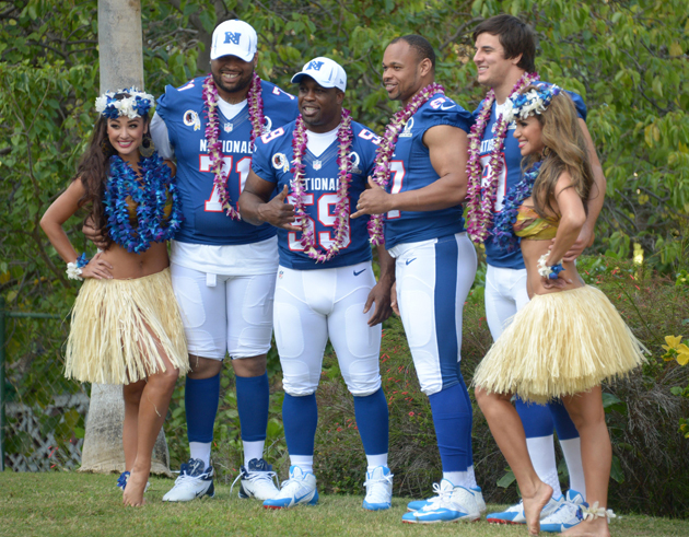 Trent Williams (71) poses with teammates London Fletcher, Lorenzo Alexander, and Ryan Kerrigan in Honolulu this week. (USAT Sports Images)