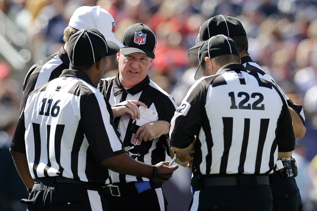 Like it or not, get used to replacement refs patrolling the field. (AP)