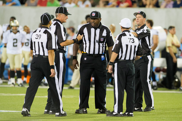 A replacement crew tries to figure it out during last week's Hall of Fame game. (Getty Images)