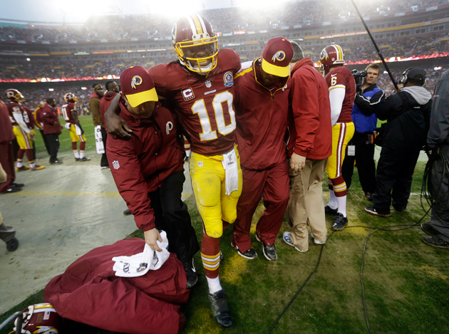 Robert Griffin needed help to leave the field against the Baltimore Ravens. (AP)