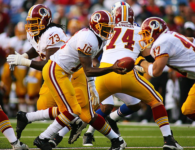 Robert Griffin III and Chris Cooley (47) connected, albeit briefly, in the preseason. (Getty Images)