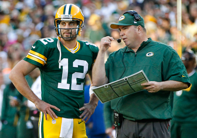 Aaron Rodgers and Mike McCarthy are still trying to figure this out. (AP)