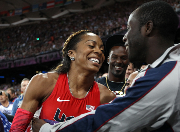Aaron Ross celebrates with wife Sanya Richards-Ross as she takes home the gold. (Getty Images)