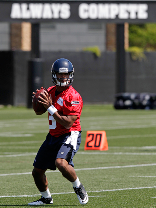 Russell Wilson plays catch -- and catch-up -- in Seattle. (AP)
