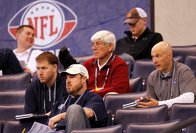 These six men are watching the same player ... and seeing him very differently. (AP)