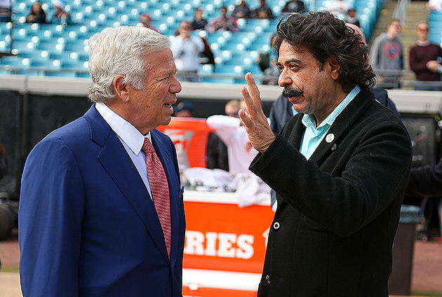 Shad Khan (r.) hired David Caldwell to run the Jaguars' football operations (Getty Images)