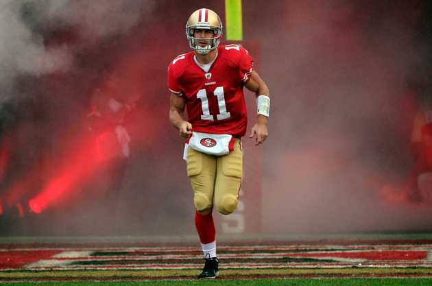 Alex Smith runs onto the field for the 2011 NFC Championship game. (AP)