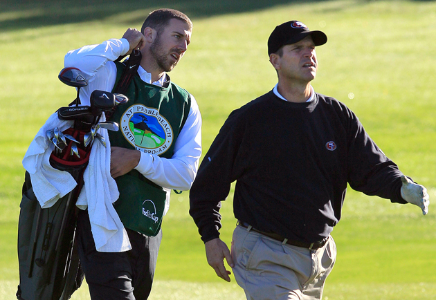 Don't expect Smith to caddy for Harbaugh again anytime soon. (AP)