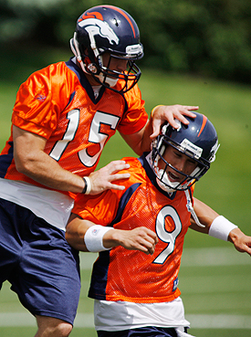 Tim Tebow and Brady Quinn horse around during the 2011 preseason. (AP)