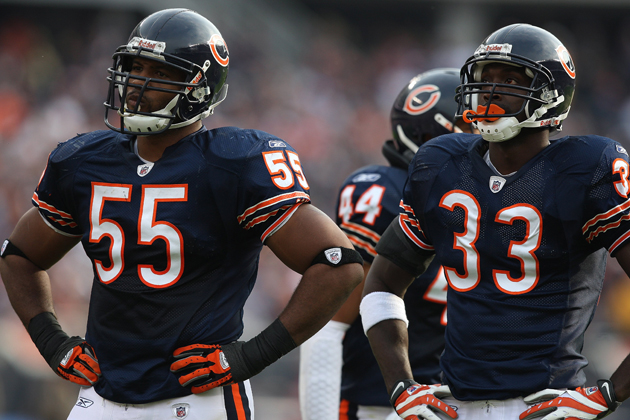 Lance Briggs (55) and Charles Tillman (33) each have more touchdowns than Calvin Johnson this season. (Getty Images)