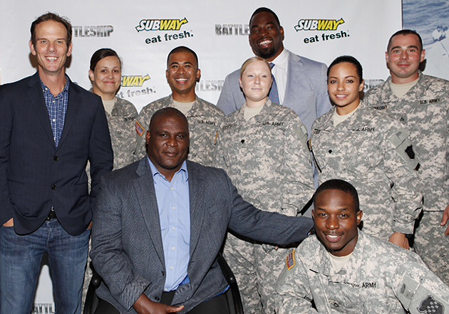 "Justin Tuck, with Col. Greg Gadson, Peter Berg, and local military at the ""Battleship"" screening. (AP)"