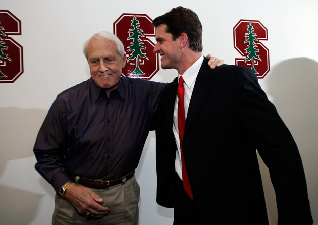 Bill Walsh introduces Stanford's new head coach in 2007. He might look familiar. (AP)