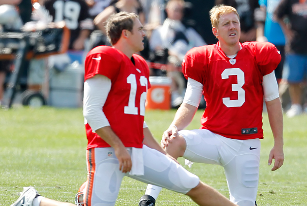 Colt McCoy (#12) and Brandon Weeden (#3). Or is it the other way around? (AP)