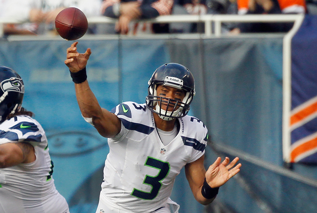 Russell Wilson riddled the Chicago Bears with timely passes and option runs. (AP)