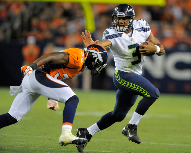 Think a short quarterback can't succeed in the NFL. Russell Wilson would like you to hold that thought. (AP)