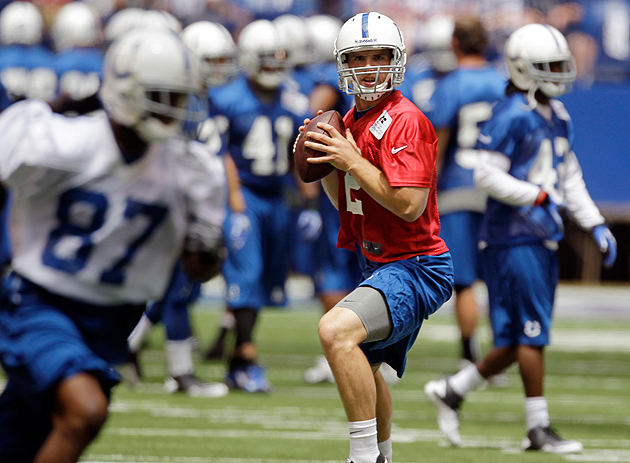 'I don't FEEL tardy!' Andrew Luck finally gets with the veterans. (AP)