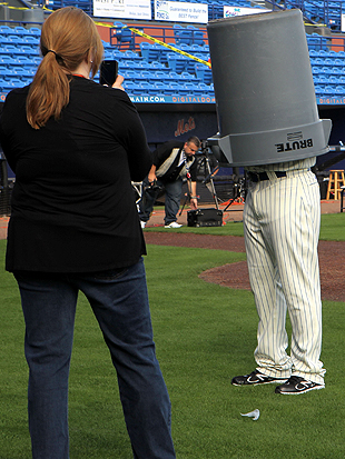 Mets pitcher Johan Santana wears a garbage can during 2012 Picture Day; perhaps this was an inspiration. (Getty)