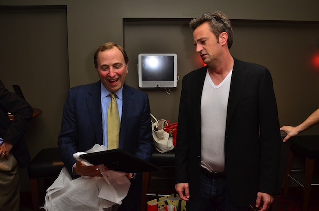 Gary Bettman reacts to the signed Janice photo Matthew Perry had no idea was in the wrapping / Getty Images