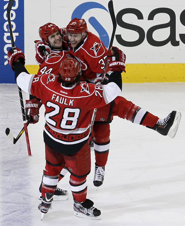 Carolina Hurricanes rockette hug - AP