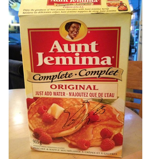 Pancakes fan Dustin Penner autographed box of Aunt Jemima; there's syrup behind Kings bench