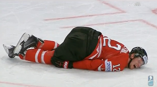 Eric Staal writhes in pain after knee-on-knee hit by Alex Edler in Worlds (Video)