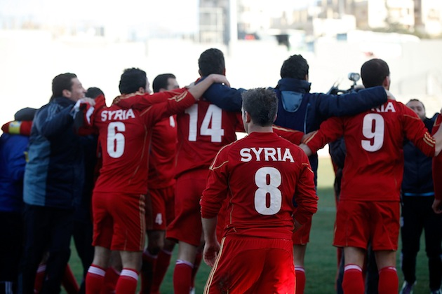 Syrian footballers after an Olympic qualifier against Japan in February. (Getty)