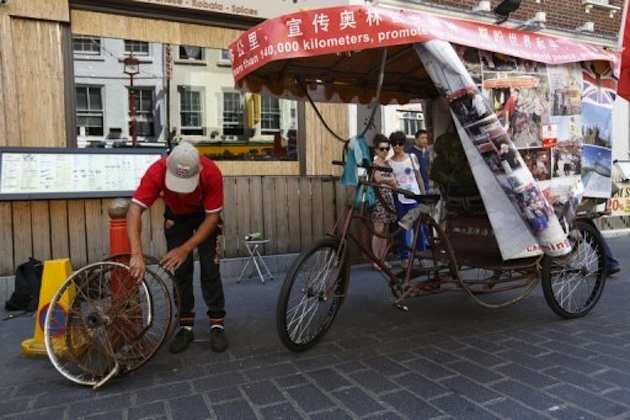 57-year-old Chinese farmer Chen Guanming, who cycled from China to London — AFP photo