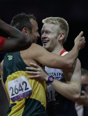 Oscar Pistorius congratulates Jonnie Peacock after Thursday's race