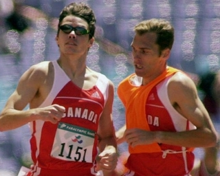 Canada's Jason Dunkerley (left) competing in the 2008 Beijing Paralympics