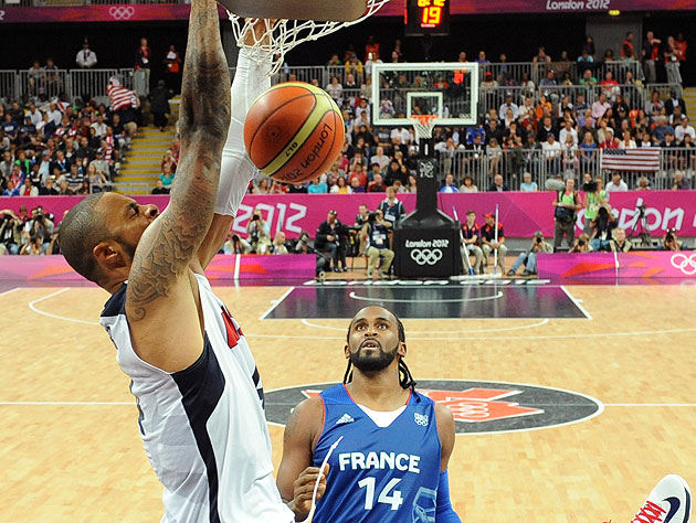France's Ronny Turiaf watches Team USA's Tyson Chandler throw down a dunk. (AP)