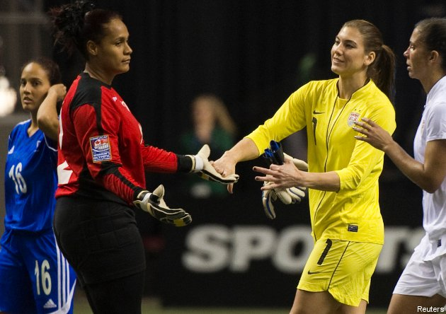 American keeper Hope Solo shakes hands with Dominican counterpart Heidy Salazar after a 14-0 U.S. win Friday.