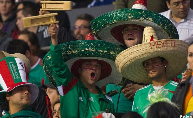 Mexican fans cheer their squad on against the U.S. Tuesday.